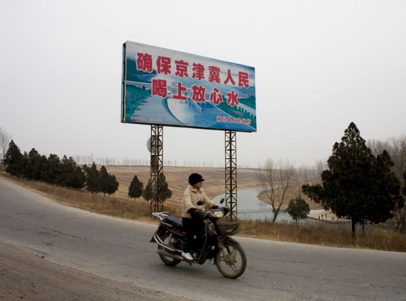 "A sign says, ""To ensure that the people of Beijing, Tianjin, and Hebei can drink safe water."" AP Photo / Andy Wong."