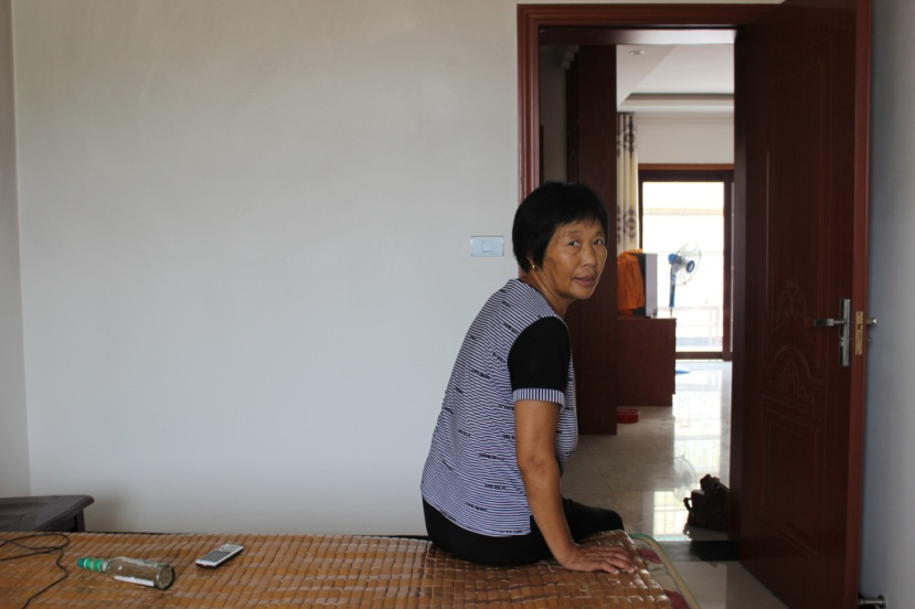 Wang Tonghuan, one of hundreds of relocated residents who now live in Jijiagou Village near Danjiangkou. Quartz / Lily Kuo.
