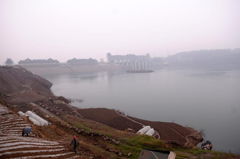 Villagers began growing vegetables after the reservoir water level receded near the water-level regulatory dam on the Pengxi River in Kaixian County, by Fan Xiao, March 2012.