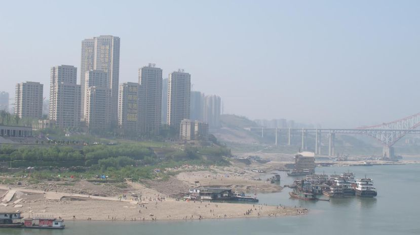 Half of the road that originally led to a cement riverside pier was buried under sand dams, by Fan Xiao, March 2013.