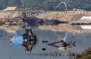 A partially-submerged factory is pictured near Jianying village in China's central Henan province on November 3, 2014.
