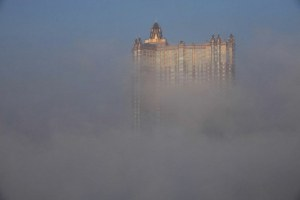 View of a high-rise building in heavy smog in Jilin province, Feb. 12, 2014. ImagineChina.