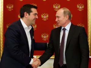 Russian President Vladimir Putin, right, and Greek Prime Minister Alexis Tsipras shake hands during a signing ceremony in the Kremlin in Moscow, Russia, Wednesday, April 8, 2015.