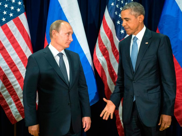 In this Monday, Sept. 28, 2015 file photo, U.S. President Barack Obama, right, and Russia's President Vladimir Putin pose for members of the media before a bilateral meeting at the United Nations headquarters. Credit: Sergey Guneyev/RIA-Novosti, Kremlin Pool Photo via AP. Credit: Sergey Guneyev/RIA-Novosti, Kremlin Pool Photo via AP.