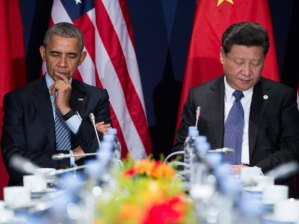 Chinese President Xi Jinping and U.S. President Barack Obama signed an agreement last November to produce a global climate change pact in Paris. Evan Vucci/AP Photo.