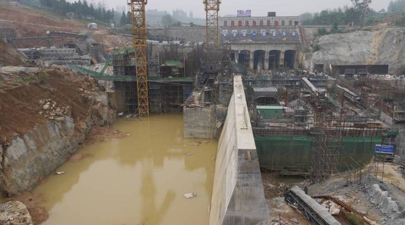Construction crews put the finishing touches on the middle route of China's South-North Water Diversion project in Henan province. The project's three routes (two of which are completed) total nearly 2700 miles of man-made waterways that divert water from China's water-rich south to its parched northern region. Rob Schmitz/Marketplace.